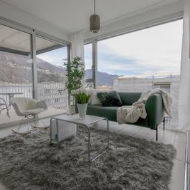 Garden Residence Ascona - Living room with view and sculptures - Kristal SA