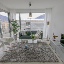 Garden Residence Ascona - Living room with large windows - Kristal SA